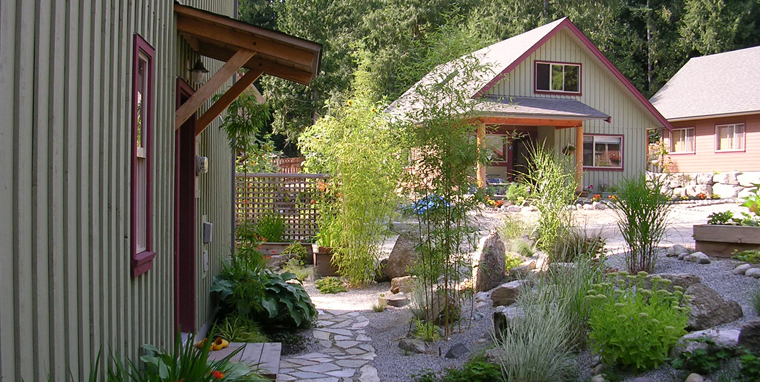 Elegant landscaping of a side yard 	at Roberts Creek Cohousing.
